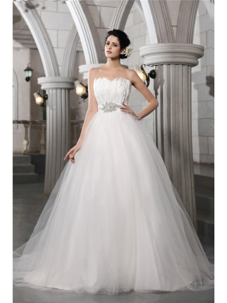 Ball Gown Beading Feathers/Fur Strapless Chapel Train Sleeveless Net Wedding Dresses